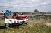 Fishing boat and castle, Holy Island, Lindisfarne, Northumberland, England, U