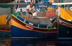 MALTA GOZO MGARR JUL00 - A fisherman washes his 'Daisa'.. . jre/Photo by Jiri Rezac. . © Jiri Rezac 2000. . Tel:   +44 (0) 7050 110 417. Email: info@jirirezac.com. Web:   www.jirirezac.com