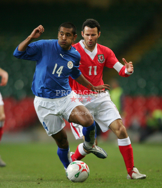 CARDIFF, WALES - WEDNESDAY, MARCH 1st, 2006: Wales' Ryan Giggs and Paraguay's Paulo da Silva during the International Friendly match at the Millennium Stadium. (Pic by Dan Istitenel/Propaganda)