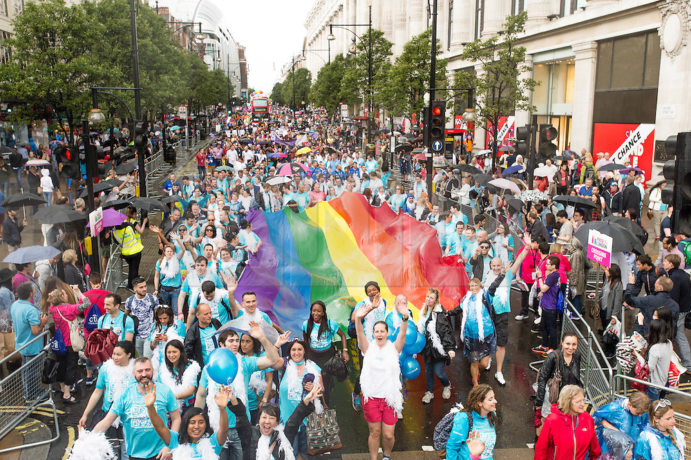 © Licensed to London News Pictures. 28/06/2014. London, UK. Member of the Lesbian Gay Bisexual and Transexual community march through central London as part of the the gay London Pride 2014 parade on a wet and raining Saturday afternoon. Photo credit : Richard Isaac/LNP