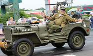 Bob Nieves drives his 1945 Willy's Military Jeep during the Lower Southampton Independence Day Parade Saturday July 4, 2015 in Feasterville, Pennsylvania. (Photo by William Thomas Cain)