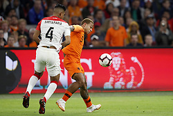 (L-R) Anderson Santamaria of Peru, Memphis Depay of Holland during the International friendly match match between The Netherlands and Peru at the Johan Cruijff Arena on September 06, 2018 in Amsterdam, The Netherlands