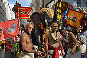 Men pulling a float with a garlanded elephant, and flags of Shiva's bull Nandi, in the parade celebrating the festival of Ganesh Chaturthi, marking the birth of the Hindu god Ganesha, on the streets of the La Chapelle area of the 18th arrondissement of Paris, France, on Sunday 1st September 2019. The annual religious festivities and parade take place near the Ganesha Temple of Paris, or Sri Manicka Vinayakar Alayam Temple, the largest Hindu temple in France. Ganesha is the elephant-headed Hindu God of Beginnings, son of Shiva and Parvati, who represents love and knowledge. Picture by Manuel Cohen