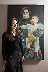 An Edinburgh College of Art graduate&rsquo;s prize-winning entry in a prestigious, worldwide portrait competition will go on show in Scotland for the first time this winter. The 2017 BP Portrait Award exhibition, which opens at the Scottish National Portrait Gallery on 18 December, will feature 53 stand-out works selected from 2,580 entries, by artists from 87 countries, including Breech! by Benjamin Sullivan which took this year's first prize. <br /> <br /> Pictured: 2016 Travel Award Winner Laura Guoke  with her painting Rima and Muhammed Ahmed