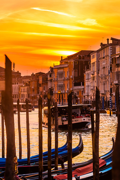 A vaporetto (water bus) on the Grand Canal at sunset, Venice, Italy.
