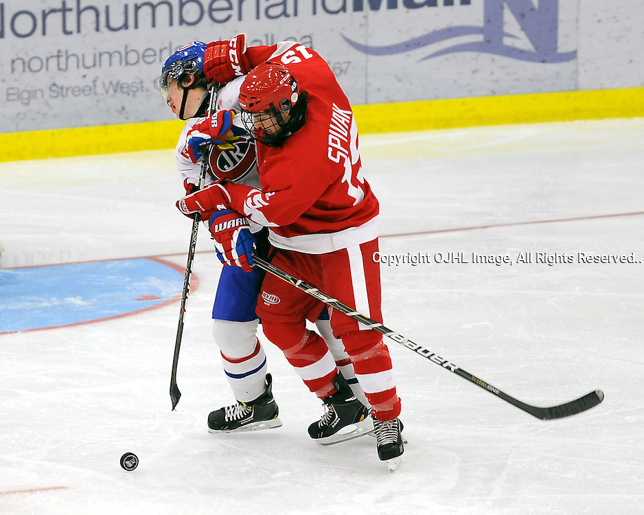 Aaron Thow #4 of the Toronto Junior Canadiens takes the hit from AaronSpivak #15 of the Hamilton Red Wings during third period game actionCOBOURG,ON-Oct14:.Ontario Junior Hockey League Game Action.between,.(Photo By Andy Corneau / OJHL Images)