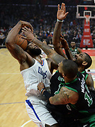 LA Clippers center DeAndre Jordan #6 is blocked by Boston Celtics forward Marcus Morris #13 and Boston Celtics guard Kyrie Irving #11 in the first half. The Los Angeles Clippers played the Boston Celtics in a regular season NBA matchup in Los Angeles, CA 1/025/2018 (Photo by John McCoy, Los Angeles Daily News/SCNG)