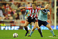 Football - Capital One Cup fourth round - Sunderland vs. Middlesbrough<br /> Lee Cattermole (Sunderland) and Grant Leadbitter (Middlesbrough) at the Stadium of Light