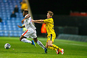 Oxford United defender Anthony McMahon (29) fouls Luton Town's Kazenga Lualua (25) during the EFL Sky Bet League 1 match between Oxford United and Luton Town at the Kassam Stadium, Oxford, England on 2 October 2018.