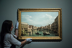 "© Licensed to London News Pictures. 06/07/2015. London, UK.  A Sotheby's technician shows Bernado Bellotto's ""Venice, a view of the Grand Canal looking south from the Palazzo Foscari and Palazzo Moro-Lin towards the chruch of Santa Maria dell Carità"" (est. £2.5m to £3.5m) at the preview of Old Masters, British Paintings and Masterworks from the collection of Castle Howard at Sotheby's ahead of the auction on July 8. Photo credit : Stephen Chung/LNP"