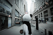 PANDA BEAR MARKET: A man dressed in a panda costume on his way to the NYSE - New York Stock Exchange - to make some money on tourists.