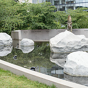 A reflection pool with large rocks at the Memorial to Japanese-American Patriotism in World War II near the US Capitol in Washington DC. The memorial was designed by Davis Buckley and Nina Akamu and commemorates those held in Japanese American internment camps during World War II.