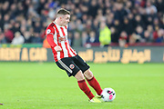 Sheffield United midfielder John Fleck (4) shoots during the Premier League match between Sheffield United and Arsenal at Bramall Lane, Sheffield, England on 21 October 2019.
