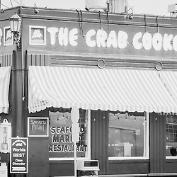 Crab Cooker Newport Beach black and white panoramic photo. The Crab Cooker is a popular landmark restaurant on Balboa Peninsula in Newport Beach, Orange County, California.  The Crab Cooker was originally a bank and was converted into a seafood restaurant. Panorama photo ratio is 1:3.