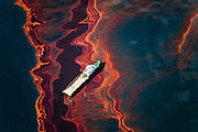 Louisiana (USA). May 6th, 2010. Aerial view of the oil leaked from the Deepwater Horizon wellhead,  the BP leased oil platform exploded April 20 and sank after burning. Leaking an estimate of more than 200,000 gallons of crude oil per day from the broken pipeline to the sea. Eleven workers are missing, presumed dead. Photo by Daniel Beltra/Greenpeace