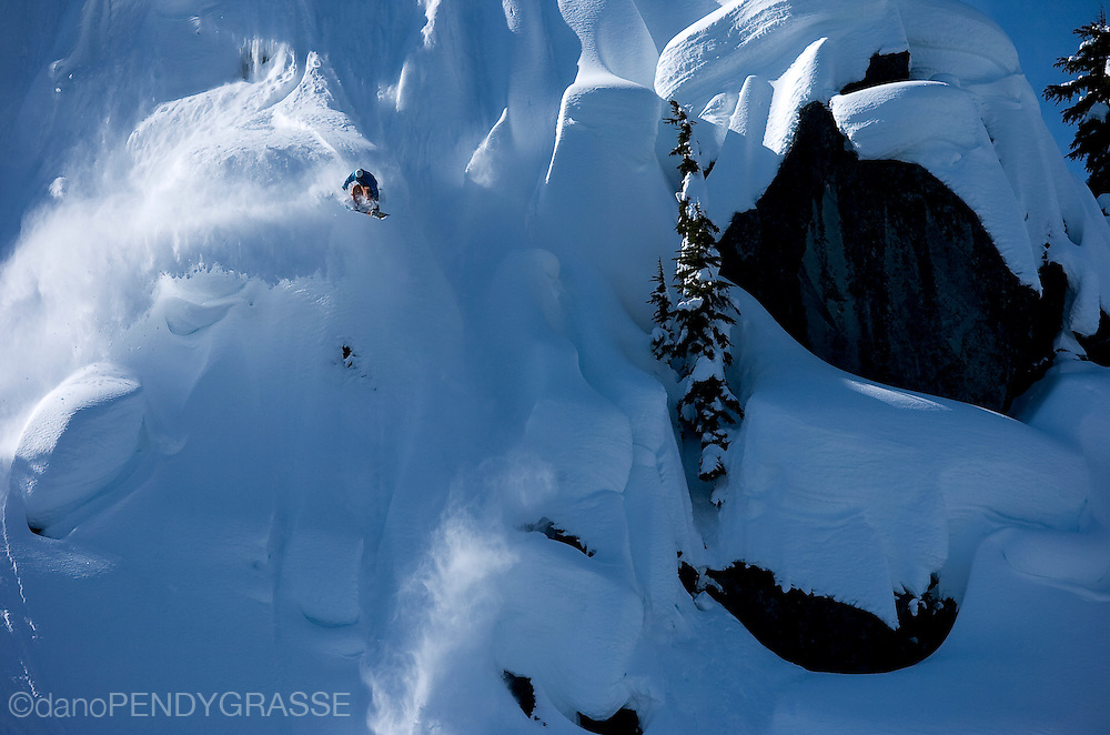 Professional snowboarder Benji Ritchie launches over a steep, snowy face in the Coast Mountain range of British Columbia. The mountains around Whistler, British Columbia are a hotbed for snowboard talent.