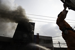 June 13, 2017 - South Jakarta, Jakarta, Indonesia - Jakarta, Tuesday,  13 June 2017 : Third floowr building burn by fire at Kebayoran Lama Market-South Jakarta. Fire fighter already at the location as the fire hit but lack of water suply made the small fire turn into big fire and took almost 3 hours to put down. No human victim found from the accident and the lost have not been calculated. (Credit Image: © Donal Husni via ZUMA Wire)