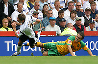 Photo: Dave Linney.<br />Derby County v Norwich City. Coca Cola Championship. 19/08/2006.Derby'sTommy Smith(L) is sent flying by  Lee Croft