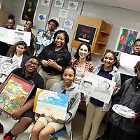 Belle-Shivers Middle School students in Valerie Brahan's artistically gifted program hold some of their works ahead of this week's art show in the school's cafeteria.