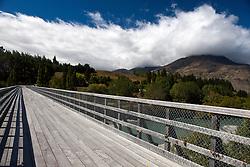 A wooden bridge crossing a river, near Queenstown, South Island, New Zealand
