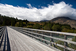 A wooden bridge crossing a river, near Queenstown, South Island, New Zealand