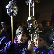 Two boys take part in the procession of the fellowship of Santa Vera Cruz, where penitents whip thwmselves, this Holy Friday in San Vicente de la Sonsierra (330km north of Madrid, in La Rioja), on April 10, 2009. This traditional procession takes its origin in the XVI century.