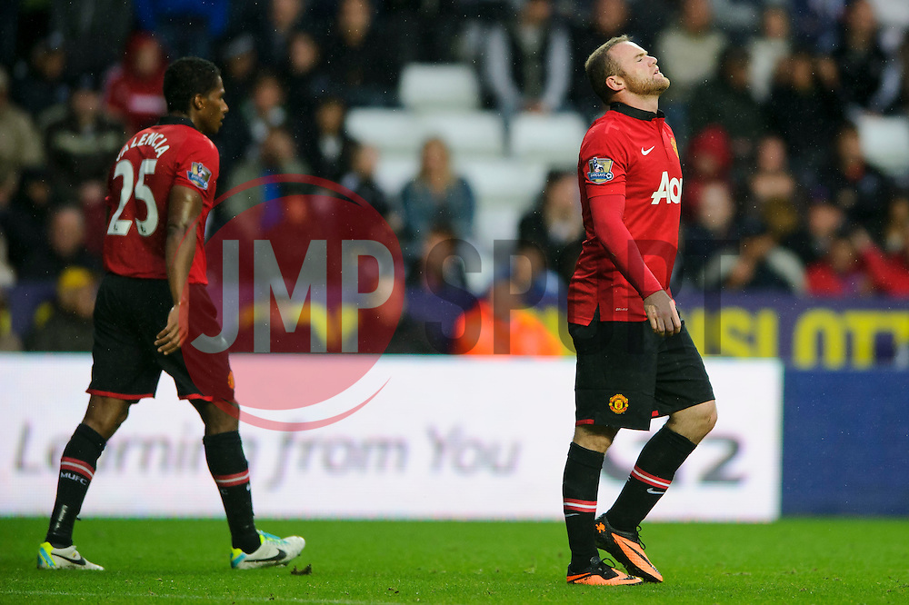 Man Utd Forward Wayne Rooney (ENG) looks frustrated after a goal from his teammate Forward Danny Welbeck (ENG) during the second half of the match - Photo mandatory by-line: Rogan Thomson/JMP - Tel: Mobile: 07966 386802 17/08/2013 - SPORT - FOOTBALL - Liberty Stadium, Swansea -  Swansea City V Manchester United - Barclays Premier League - First round of the 2013/14 season and the first league match for new Man Utd manager David Moyes.