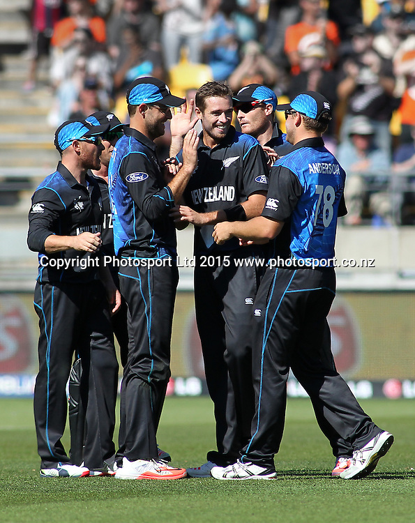 Black Caps players celebrate another wicket to Tim Southee during the ICC Cricket World Cup match between New Zealand and England at Wellington Regional Stadium, New Zealand. Friday 20th February 2015. Photo.: Grant Down / www.photosport.co.nz