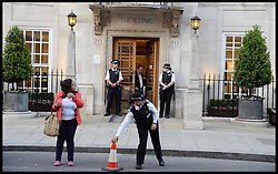 Police Officers stand outside The London Clinic Hospital, London Clinic Hospital. The Duke of Edinburgh has been admitted to the Hospital for exploratory operation following abdominal investigations, Thursday, 6th June 2013,Picture by Andrew Parsons / i-Images