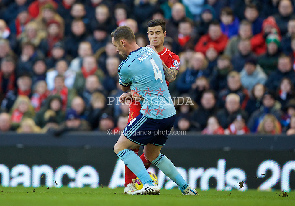 LIVERPOOL, ENGLAND - Saturday, January 31, 2015: Liverpool's Philippe Coutinho Correia is fouled by West Ham United's captain Kevin Nolan during the Premier League match at Anfield. (Pic by David Rawcliffe/Propaganda)