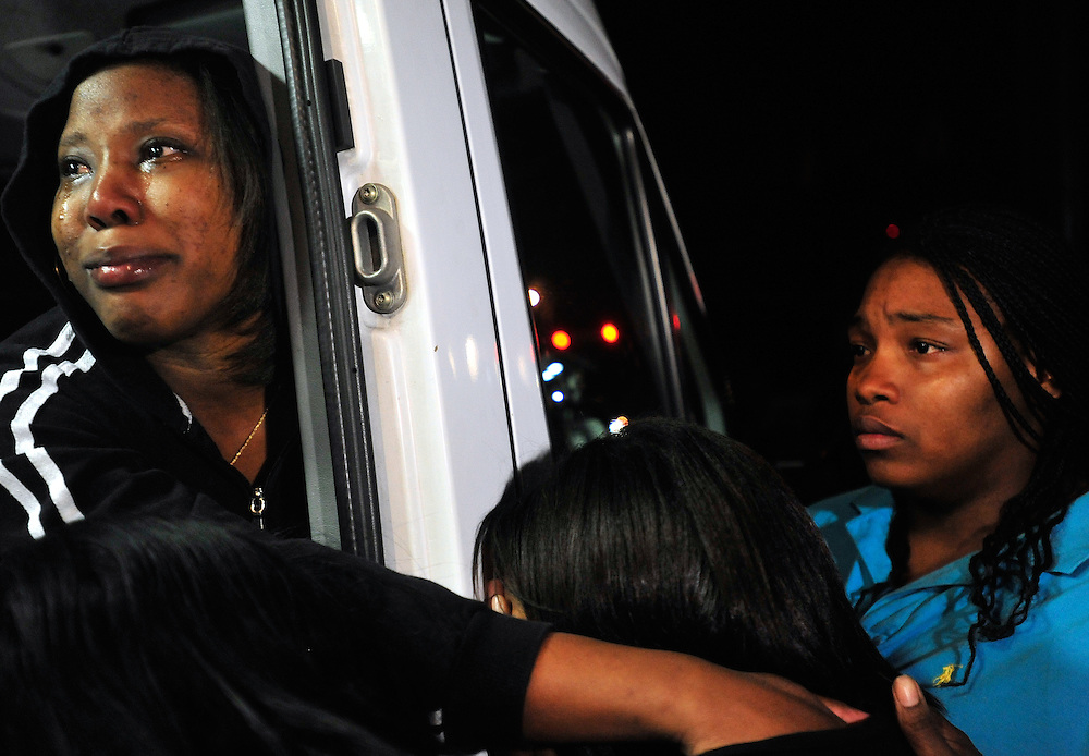 Brandi Johnson, right, and a friend who did not want to be identified by name, left, comfort Jennifer Hood, sister of Jamie Hood, as they watch from the back of a news van as Jamie Hood surrenders to the police after a four day manhunt on Friday, March 25, 2011 in Athens, Ga.  (Richard Hamm/Staff/richard.hamm@onlineathens).
