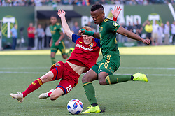 October 21, 2018 - Portland, OR, U.S. - PORTLAND, OR - OCTOBER 21, 2018: Portland Timbers forward Jeremy Ebobisse attempts a shot on goal blocked by Real Salt Lake defender Justen Glad during the Portland Timbers 3-0 victory over Real Salt lake on October 21, 2018, at Providence Park in Portland, Oregon. (Photo by Diego Diaz/Icon Sportswire) (Credit Image: © Diego Diaz/Icon SMI via ZUMA Press)