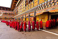 Monks in procession at the Paro Teschu festival, Paro Dzong Monastery,  Paro Valley, Bhutan