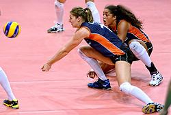 24-09-2014 ITA: World Championship Volleyball Thailand - Nederland, Verona<br /> Anne Buijs en Celeste Plak pakken samen de bal. De pass moet morgen tegen USA perfect zijn.