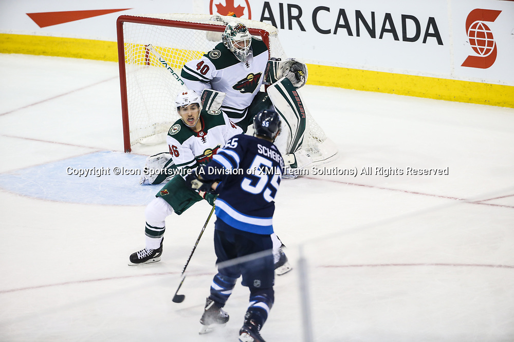 WINNIPEG, MB – April 11: Winnipeg Jets forward Mark Scheifele (55) is stopped by Minnesota Wild goalie Devan Dubnyk (40) during the Stanley Cup Playoffs First Round Game 1 between the Winnipeg Jets and the Minnesota Wild on April 11, 2018 at the Bell MTS Place in Winnipeg MB. (Photo by Terrence Lee/Icon Sportswire)