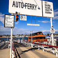 Photo of Balboa Island Auto Ferry in Newport Beach California. The auto ferry carries cars and people from Balboa Peninsula across Newport Harbor to Balboa Island in Orange County Southern California.