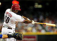 Jul. 17 2011; Phoenix, AZ, USA; Arizona Diamondbacks outfielder Justin Upton (10) bats against the Los Angeles Dodgers at Chase Field. The Dodgers defeated the Diamondbacks 6-4.  Mandatory Credit: Jennifer Stewart-US PRESSWIRE