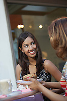 Two women chatting at cafe table