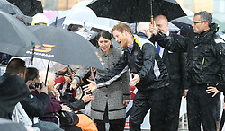 Prince Harry reaches out to Daphne Dunne, 97, on a walkabout on Circular Quay in Sydney, Australia, during a day of events to mark the official launch of the Invictus Games Sydney 2018.