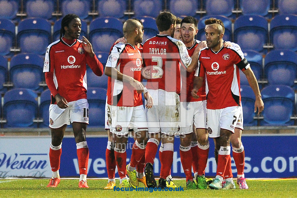 Michael Cain of Walsall (2nd right) celebrates scoring his sides second goal to make the scoreline 2-0 during the Sky Bet League 1 match between Colchester United and Walsall at the Weston Homes Community Stadium, Colchester<br /> Picture by Richard Blaxall/Focus Images Ltd +44 7853 364624<br /> 17/01/2015
