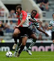 Photo. Jed Wee, Digitalsport<br /> Feyenoord Rotterdam v Sporting Lisbon, Newcastle Gateshead Cup, 31/07/2004.<br /> Feyenoord's Bart Goor (L) is tackled by Sporting's Paulo Hinga.