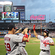 NEW YORK, NEW YORK - July 07: Anthony Rendon #6 of the Washington Nationals is congratulated by Jose Lobaton #59 of the Washington Nationals as he returns to the dugout after hitting a home run during the Washington Nationals Vs New York Mets regular season MLB game at Citi Field on July 07, 2016 in New York City. (Photo by Tim Clayton/Corbis via Getty Images)