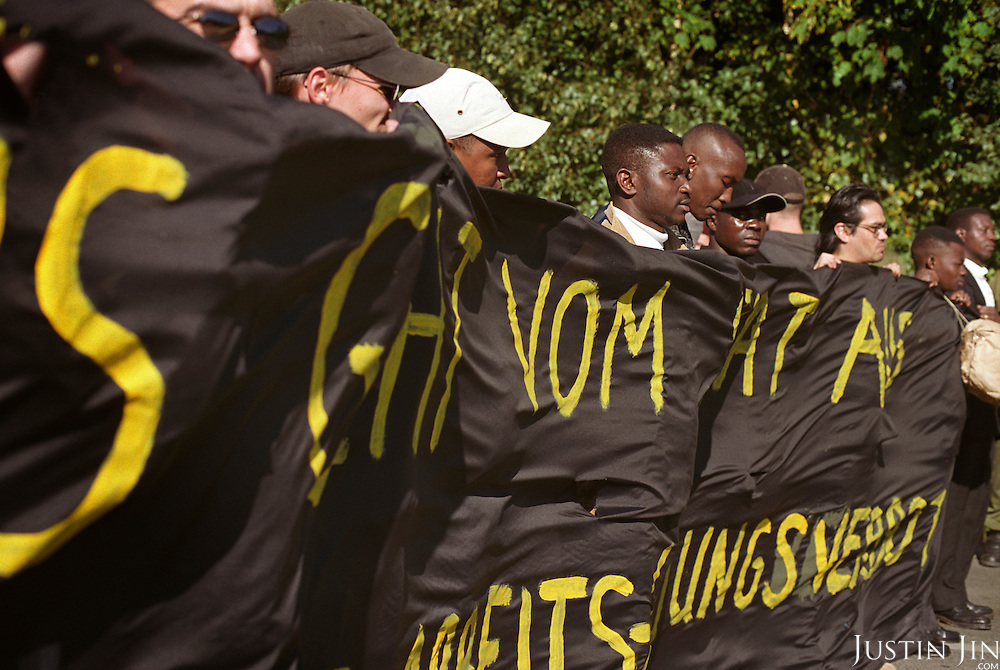 Refugees, led by activist Christopher Nsoh, stage a demonstration against institutional racism in the Germany city of Potzdam..Picture taken 2000 by Justin Jin. ..