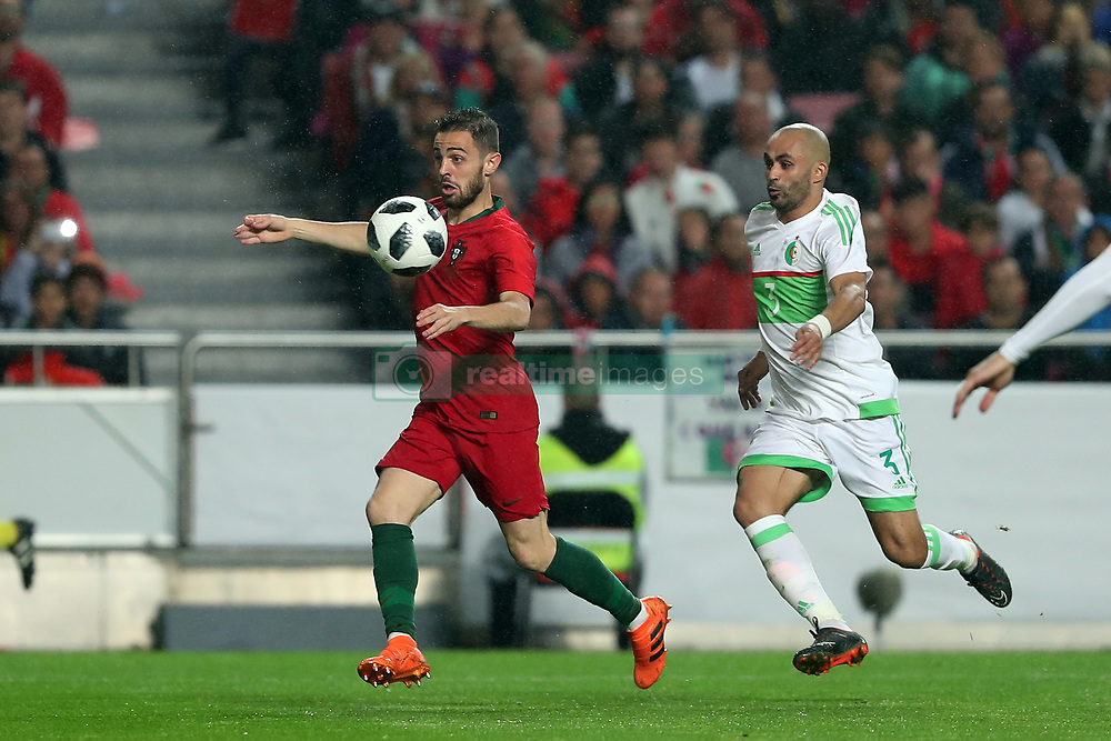 June 7, 2018 - Lisbon, Portugal - Portugal's forward Bernardo Silva (L) vies with Algerias defender Mokhtar Benmoussa during the FIFA World Cup Russia 2018 preparation football match Portugal vs Algeria, at the Luz stadium in Lisbon, Portugal, on June 7, 2018. (Portugal won 3-0) (Credit Image: © Pedro Fiuza/NurPhoto via ZUMA Press)