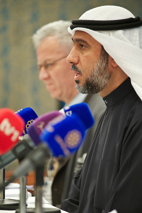 KTS Chairman Salah Al Ghazali (right) addresses a news conference on the parliamentry elections in Kuwait City, February 3, 2012.  Kuwaiti voters chose among 285 candidates running for the new 50-seat assembly.