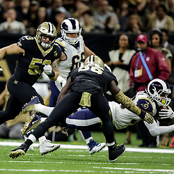 Nov 4, 2018; New Orleans, LA, USA; Los Angeles Rams running back Todd Gurley (30) dives past New Orleans Saints cornerback P.J. Williams (26) during the first half at the Mercedes-Benz Superdome. Mandatory Credit: Derick E. Hingle-USA TODAY Sports