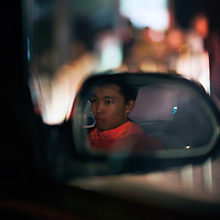 BEIJING, OCT.18, 2014 : Song Yonglin,14, slightly stressed out, heads back to his apartment before he is going out again for a basketball game. He  spends every weekend taking extra school lessons in order to improve his scores which cost his parents about 4-5000 Yuan/month. He would like to switch to the International school in Beijing  and study economics later on in the US.