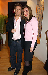 Musician BRYAN ADAMS and SARA DAVENPORT founder of the London Haven at a party attended by HRH The Countess of Wessex to celebrate the 5th birthday of Breast Cancer Haven's - The London Haven, Effie Road, London on 10th February 2005.<br />