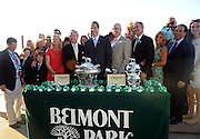 Tonalist owner Robert Evans, center left, and New York Governor Andrew Cuomo, center, attend the trophy presentation after Tonalist won the 146th Belmont Stakes, beating out Triple Crown hopeful California Chrome, Saturday, June 7, 2014, at Belmont Park in New York.  Longines, the Swiss watchmaker known for its elegant timepieces, is the Official Watch and Timekeeper of the 146th running of the Belmont Stakes and the Triple Crown. (Photo by Diane Bondareff/Invision for Longines/AP Images)