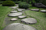 Stepping Stones at Kiyosumi Teien Garden -  the site of the residence of the Edo Period  magnate, Kinokuniya Bunzaemon. Later it became the residence of the Lord of Sekiyado castle, the period when the basic form of the garden came into existence.  In 1878  Iwasaki Yataro chose this property as a garden for the entertainment of important guests. In later years, famous rocks from all over Japan were brought in to embellish the garden. The garden was completed in the Meiji Period and developed into a famous strolling garden centered around its large pond.